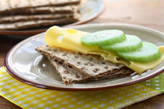 Breakfast with crispbread. Close up of crispbread slices with cheese and cucumber Royalty Free Stock Photo