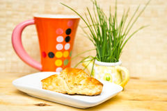 Breakfast croissant. And tea cup Royalty Free Stock Photo