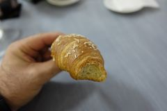 Breakfast with a croissant. In bar Royalty Free Stock Images