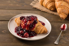 Breakfast croissant with cherry jam Royalty Free Stock Images