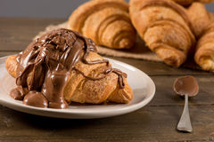 Breakfast croissant with chocolate. On a rustic background Royalty Free Stock Photo