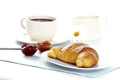 Breakfast with croissant and coffee. Breakfast with a croissant,a cup of coffee and two kinds of jam stock photos