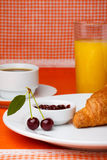 Breakfast with croissant, coffee and juice Royalty Free Stock Photo