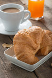 Breakfast with croissant, coffee and orange juice. Royalty Free Stock Photos