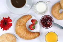 Breakfast with croissant, coffee and orange juice from above. Breakfast with a croissant, bagels, marmalade, coffee and orange juice from above Royalty Free Stock Photo