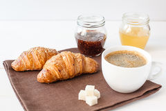 Breakfast with croissant and cup of coffee Royalty Free Stock Photo