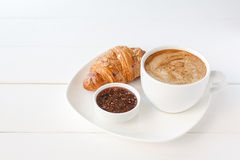 Breakfast with croissant and cup of coffee. On the tableclothes Stock Photography