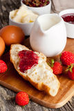 Breakfast with croissant, jam, fresh berries and butter. Breakfast with croissants, eggs, muesli and fresh berries, vertical Stock Photography