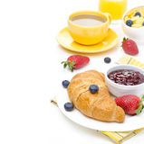 Breakfast with croissant, jam, fresh berries, coffee Stock Photography