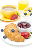 Breakfast with croissant, jam, fresh berries and coffee Royalty Free Stock Image
