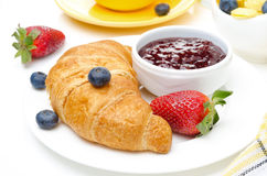 Breakfast with croissant, jam, fresh berries Royalty Free Stock Photos