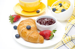 Breakfast with croissant, jam, fresh berries and coffee Stock Image