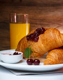 Breakfast with croissant and juice Stock Photography