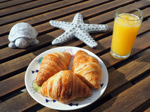 Breakfast. With croissant and orange juice Royalty Free Stock Photo