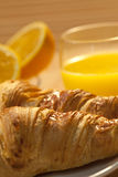 Breakfast Croissant, Oranges and Orange Juice Royalty Free Stock Photo
