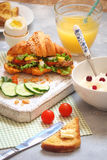 Breakfast with croissant sandwich, rice, Casas berries, boiled e Royalty Free Stock Photography