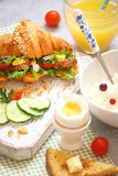 Breakfast with croissant sandwich, rice, Casas berries, boiled e Stock Photos