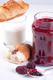 Breakfast with croissant and strawberry jam Stock Photography