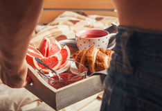 Breakfast with croissant and tea in bed Royalty Free Stock Image