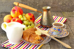 Breakfast with croissants, coffee and fruit Stock Photos