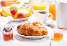 Breakfast with croissants, coffee, orange juice, toasts and frui Royalty Free Stock Photos