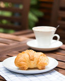 Breakfast with croissants, cup of coffee Stock Images