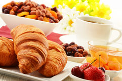Breakfast with croissants cup of coffee and fruits Royalty Free Stock Photos