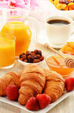 Breakfast with croissants cup of coffee and fruits Royalty Free Stock Image