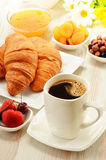 Breakfast with croissants cup of coffee and fruits Royalty Free Stock Images