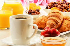 Breakfast with croissants cup of coffee and fruits Royalty Free Stock Photo