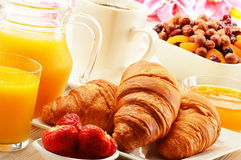 Breakfast with croissants cup of coffee and fruits Stock Images