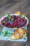 Breakfast with croissants and  forest fruits Royalty Free Stock Image