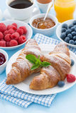 Breakfast with croissants, fresh berries and orange juice Stock Photo