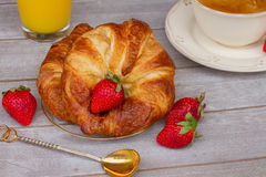 Breakfast with croissants and fresh berries Stock Image