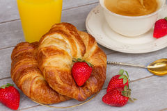 Breakfast with croissants and fresh berries Royalty Free Stock Photography