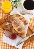 Breakfast with croissants, jam, cup of coffee and orange juice Stock Photo