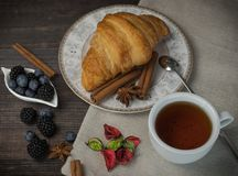 Breakfast with croissants, leaves. Flat lay, top view stock photography