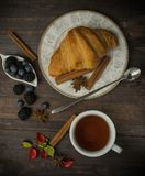 Breakfast with croissants, leaves. Flat lay, top view royalty free stock images