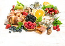 Breakfast with croissants, muesli, fresh berries, fruits. Health Royalty Free Stock Photography