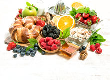 Breakfast with croissants, muesli, fresh berries, fruits. Health Stock Images