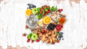 Breakfast with croissants, muesli, fresh berries, fruits. Health Royalty Free Stock Image