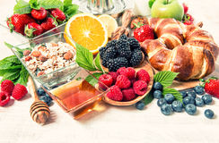 Breakfast with croissants, muesli, fresh berries. Healthy nutrit Stock Photo
