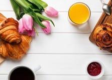 Breakfast with croissants, orange juice and coffee Stock Image
