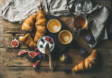 Breakfast with croissants, ricotta, figs, fresh berries, honey and espresso Stock Images