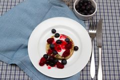 Breakfast crumpets. A baked crumpet with yoghurt and fresh fruits and orange juice for breakfast Stock Image