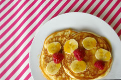 Breakfast crumpets with banana and raspberry Stock Images