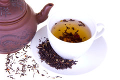 A breakfast with a cup of aroma tea. Tea pot and a cup of tea on a white isolated background Stock Photos