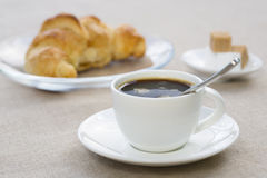 Breakfast with cup of black coffee and croissant Stock Photo