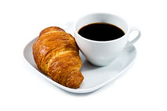 Breakfast with cup of black coffee and croissant. Breakfast with cup of black coffee, croissant on white plat isolated on wite background Royalty Free Stock Photography