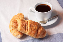 Breakfast with cup of black coffee and  croissants Stock Photo
